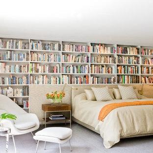 Ejemplo de habitación de invitados contemporánea, sin chimenea, con paredes blancas y moqueta