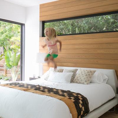 Bedroom - contemporary bedroom idea in Tampa with brown walls