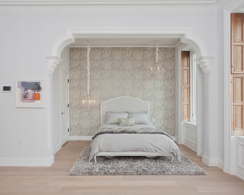Inspiration for a large transitional master light wood floor bedroom  remodel in New York with gray