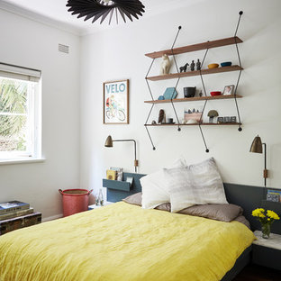 Design ideas for a mid-sized contemporary guest bedroom in Sydney with white walls, dark hardwood floors and brown floor.