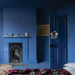 A bedroom painted in Pitch Blue No.220 by Farrow & Ball