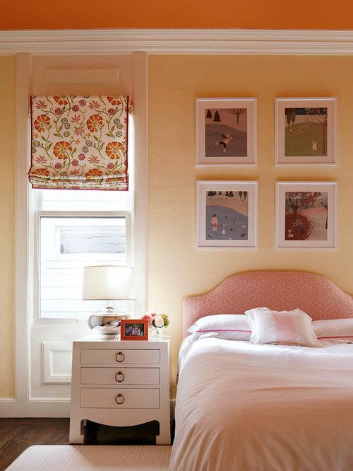 Camera degli ospiti classica con pareti gialle foto e for Arredare camera ospiti
