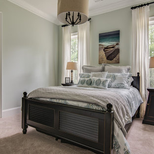 Example of a mid-sized beach style guest carpeted and beige floor bedroom design in Charlotte with no fireplace and gray walls