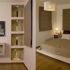 modern bedroom by Pratim Studio