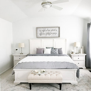 Inspiration for a mid-sized shabby-chic style carpeted and beige floor bedroom remodel in New York with white walls