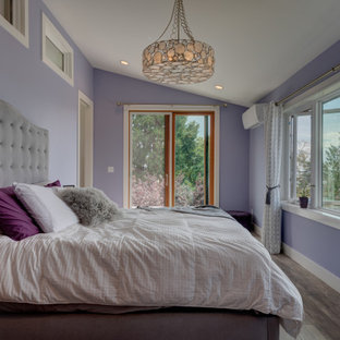 Mid-sized master vinyl floor, gray floor and vaulted ceiling bedroom photo in Seattle with purple walls