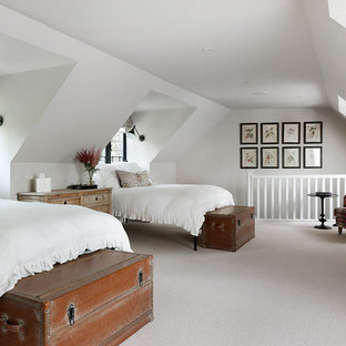 Inspiration for a timeless guest carpeted bedroom remodel in London with white walls