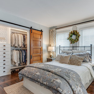 Example of a country bedroom design in Chicago
