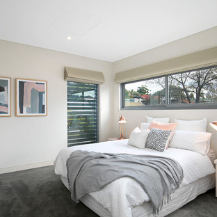 Small contemporary guest bedroom in Sydney with white walls, carpet, grey floor and no fireplace.