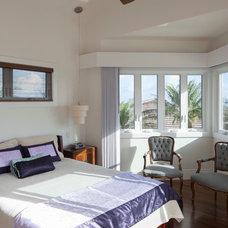 Tropical Bedroom by Barker Kappelle Construction, LLC