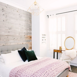 A rustic bedroom with a touch of blush and brass