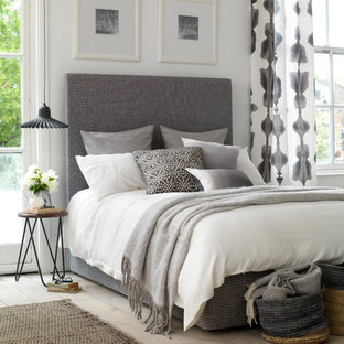 A smart and stylish bedroom with grey tones