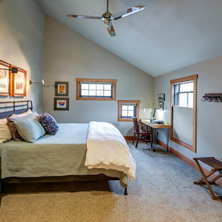 Large arts and crafts guest carpeted and beige floor bedroom photo with beige walls