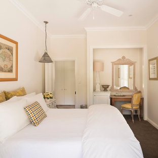 Inspiration for a traditional bedroom in Sydney with beige walls, carpet and no fireplace.