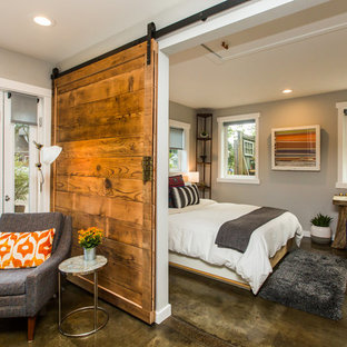 Design ideas for a mid-sized country master bedroom in Portland with grey walls, concrete floors, no fireplace and brown floor.
