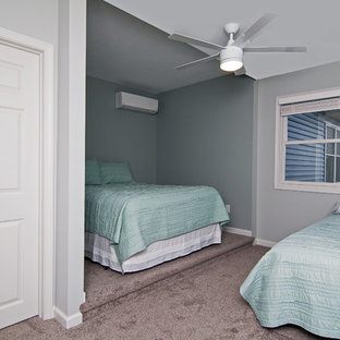 Example of a mid-sized beach style guest carpeted and beige floor bedroom design in Chicago with gray walls