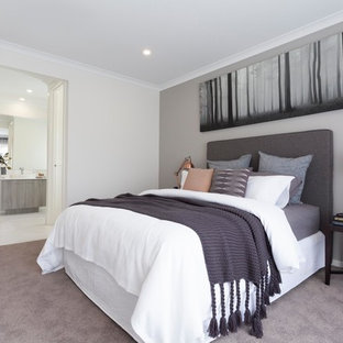 Inspiration for a contemporary master bedroom in Melbourne with white walls, carpet and beige floor.