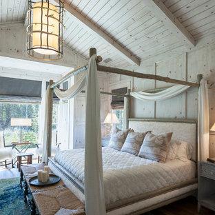 Inspiration for a huge rustic master bedroom remodel in Grand Rapids