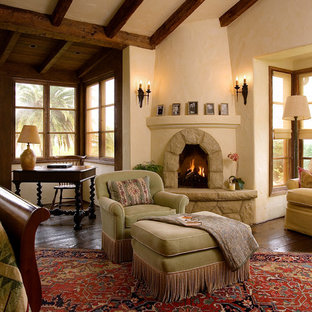 Huge southwest master dark wood floor bedroom photo in Santa Barbara with a corner fireplace, beige walls and a stone fireplace