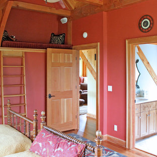 Example of a mid-sized mountain style loft-style medium tone wood floor bedroom design in Richmond with red walls and no fireplace