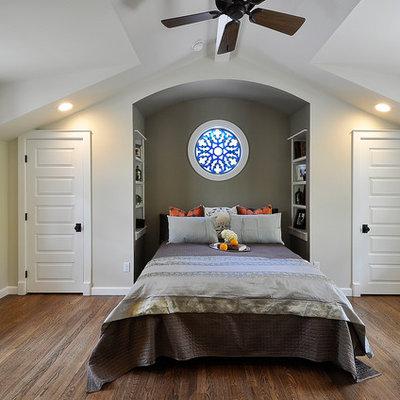 Elegant dark wood floor bedroom photo in Austin with gray walls