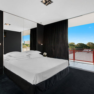 Mid-sized contemporary master bedroom in Sydney with black walls, carpet, black floor and no fireplace.