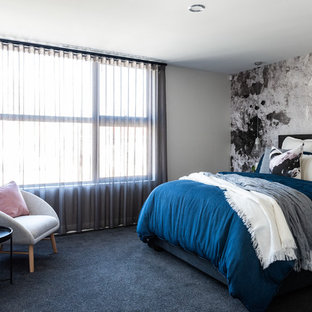 This is an example of a contemporary bedroom in Perth with grey walls, carpet and blue floor.