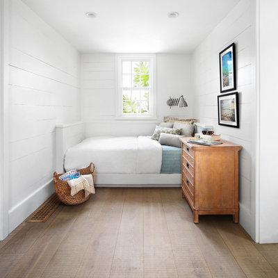 Bedroom - small coastal medium tone wood floor bedroom idea in Other with white walls