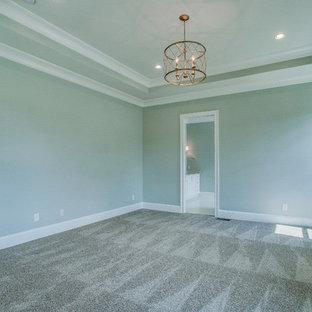 Ejemplo de dormitorio clásico, grande, con paredes beige, suelo de madera oscura, chimenea tradicional y marco de chimenea de ladrillo