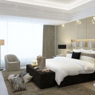 Foto de habitación de invitados de estilo americano, grande, sin chimenea, con paredes grises, suelo laminado y suelo multicolor