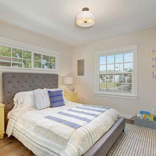 Bedroom - transitional medium tone wood floor bedroom idea in Los Angeles with beige walls