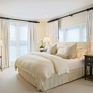 Inspiration for a beach style carpeted bedroom remodel in New York with beige walls and no fireplace