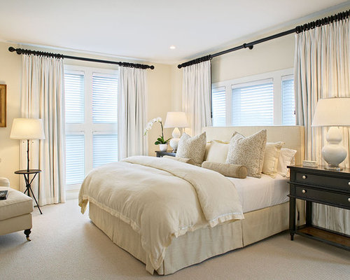 inspiration for a beach style bedroom remodel in new york with beige walls and carpet - White Bedroom Design