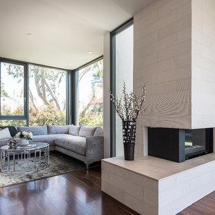 Idéer för ett mellanstort modernt huvudsovrum, med vita väggar, mörkt trägolv, en spiselkrans i sten och en öppen hörnspis