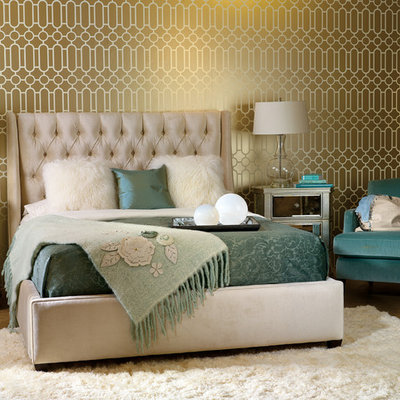 Example of a transitional bedroom design in Houston with green walls