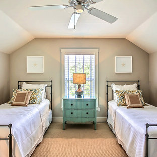 Inspiration for a mid-sized beach style guest carpeted and brown floor bedroom remodel in Jacksonville with gray walls