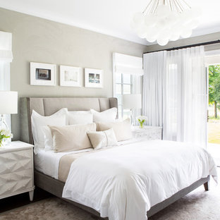 Inspiration for a mid-sized farmhouse master bedroom remodel in New York with beige walls