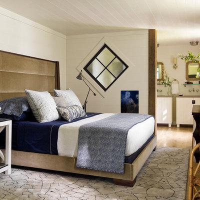 Example of a trendy bedroom design in New York with white walls