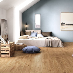 Example of a large danish master light wood floor bedroom design in Indianapolis with blue walls and no fireplace