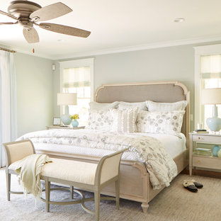 Example of a mid-sized transitional master medium tone wood floor and brown floor bedroom design in Boston with gray walls