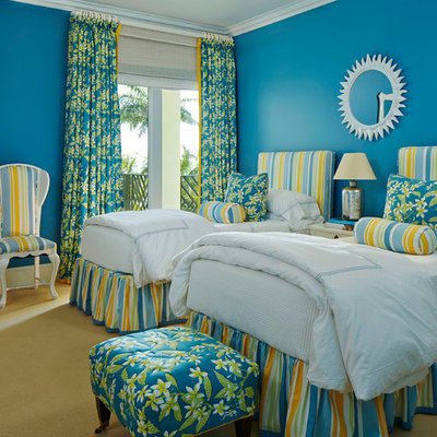 Example of an island style guest carpeted and yellow floor bedroom design in Miami with blue walls and no fireplace