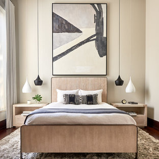 Inspiration for a mid-sized contemporary master dark wood floor and brown floor bedroom remodel in Charlotte with beige walls