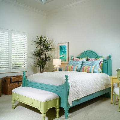Inspiration for a tropical carpeted bedroom remodel in Miami with white walls