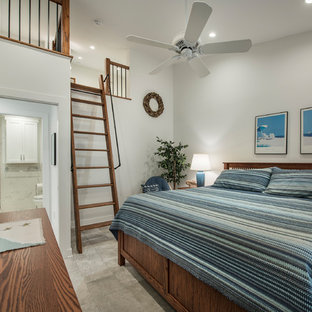 Bedroom - mid-sized beach style master ceramic floor and beige floor bedroom idea in Other with white walls