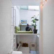 Visite Privée : Une double hauteur optimise un 21 m² en sous-sol