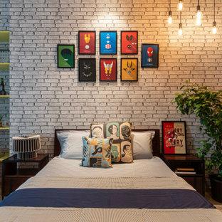 Imagen de dormitorio industrial con paredes grises, suelo de cemento y suelo gris