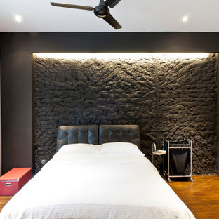 Inspiration for an urban bedroom in Singapore with black walls.