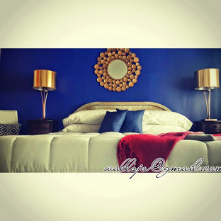 Example of an eclectic master bedroom design in Other with blue walls