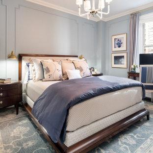 Mid-sized elegant master dark wood floor and brown floor bedroom photo in New York with blue walls
