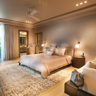 Large contemporary bedroom in Delhi with beige walls.